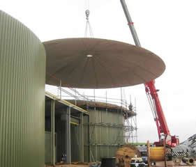 Positioning fibreglass roof onto concrete tank