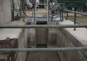 Back view of simple mixing and oading pit