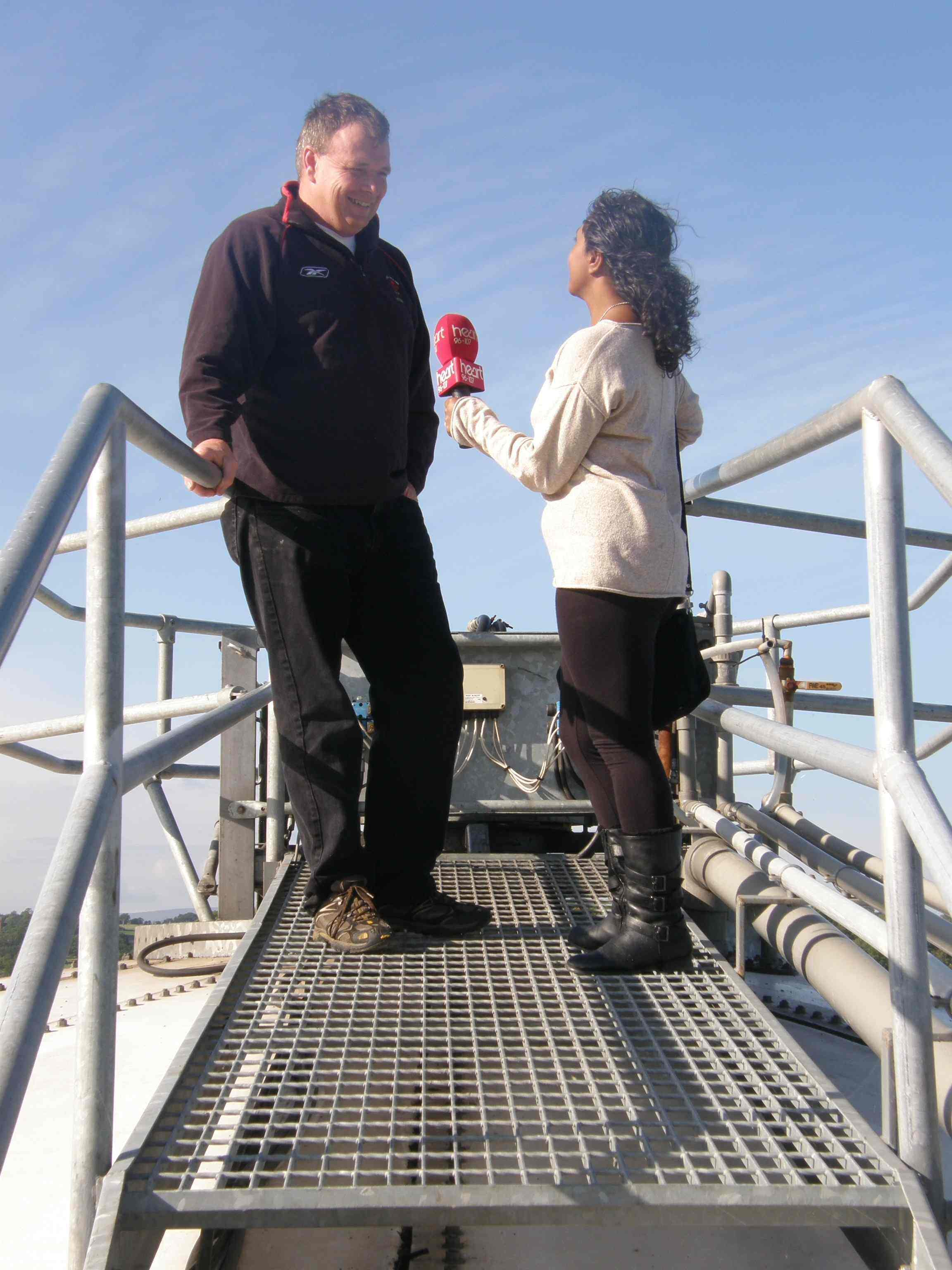 Richard Tomlinson and Charlene Smith on top of the Fre-energy digester at Lodge Farm